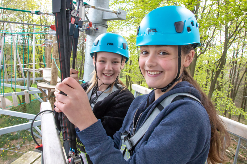 Two girls enjoying the high ropes