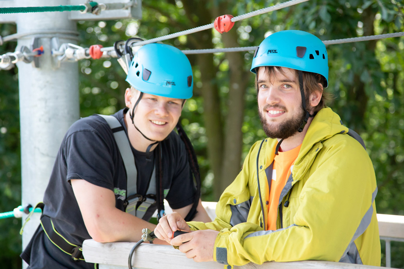Two men enjoying the high ropes adventure