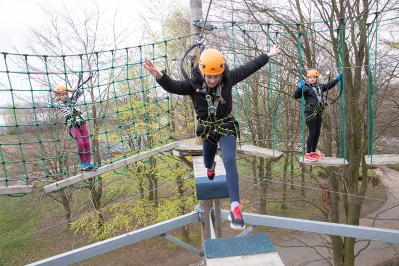 Image of a girl on the sky reach course