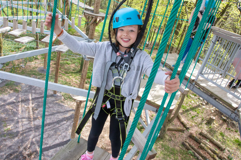 A photo of a girl enjoying the high ropes